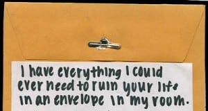 An envelope with a blackmail note on it.
